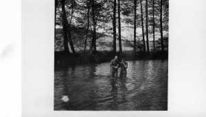 Chaplain Frank M. Arnold baptizes a solider during World War II.