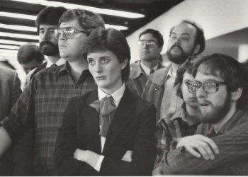 Colleagues at the Des Moines Register and I (in beard and glasses at right) learned in 1985 that the company was being sold to Gannett. That day Rick Tapscott asked Barb Musfeldt who would be someone good at the Register to hire for an opening at the Kansas City Times. She mentioned me.
