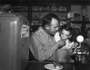 Bob Moore shares a hamburger with Nancy after his homecoming.