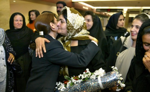 Afghan women arrived in Omaha under the sponsorship of the University of Nebraska at Omaha. Saleemah, a teacher from Kabul and wearing a scarf is hugged by Masuma Basheer, an employee of America West Airlines in Omaha and a formerly from Afghanistan. (Omaha World-Herald photo by Bill Batson, used by permission)