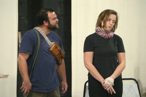 "Hank Hilbert (Hamood), left, and Tammy Meneghini rehearse William Mastrosimone's play ""The Afghan Women,"" on Thursday, October 16, 2003, at The Loft at the Mill in Lincoln, Neb. (World-Herald photo by Matt Miller, used by permission)"