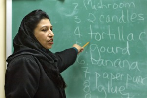 Parween Arghandaywal pronounces words during English class at the University of Nebraska Omaha for visiting Afghan teachers in 2002. (Omaha World-Herald Photo by Bill Batson, used by permission)