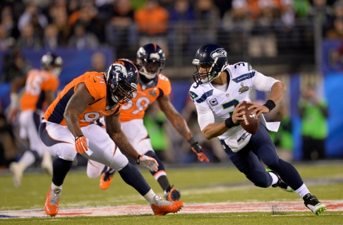 Russell Wilson didn't pass for as many yards as Peyton Manning in the Super Bowl, but he still had a better game. John Leyba/The Denver Post. Used with permission.