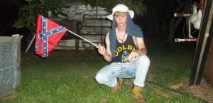 The suspect in the Charleston terrorist attack posted a photo of himself waving a Confederate flag.
