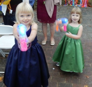 Julia and Madeline armed with bubble guns.