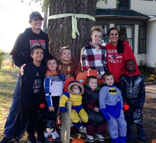 Luke Buttry's family at Halloween. Parents Luke and Kathy stand on the ends, with daughter Hailie standing about as tall as her mother. Trenton, adopted from Haiti, is standing by Kathy. Sitting, left to right, are Grayson, Kyler and Landry. Standing in front of Luke, from left, are Andreas, Brody and Carter.