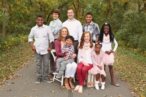 The Poulter family: Standing from left: Denzel, Ethan, Matt, Shay, Maya; sitting, Mandy with Keaton on her lap, Whitley, Chelsea.