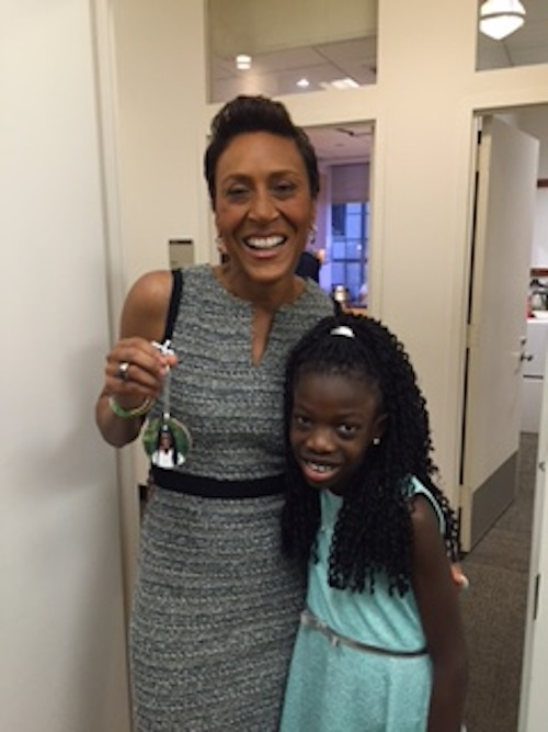 Maya gave Robin Roberts a Christmas tree ornament.