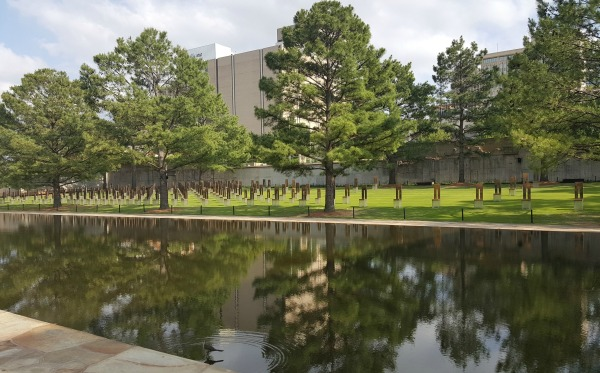 A peaceful lawn and reflecting pool contrast with the horror at this site 21 years ago. Memorial chairs symbolize each of the 168 people killed in the terrorist attack.