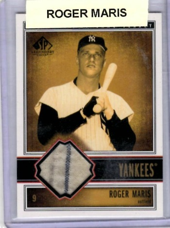 My Roger Maris baseball card, which I've given to my son Joe.